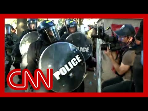 Video shows US police attack Australian journalists